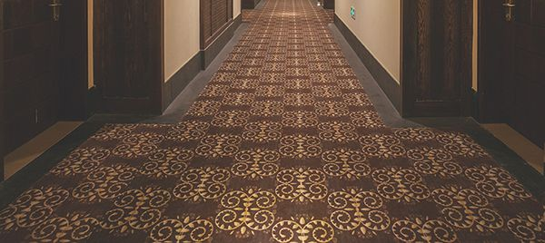 Patterned carpet in a long hallway