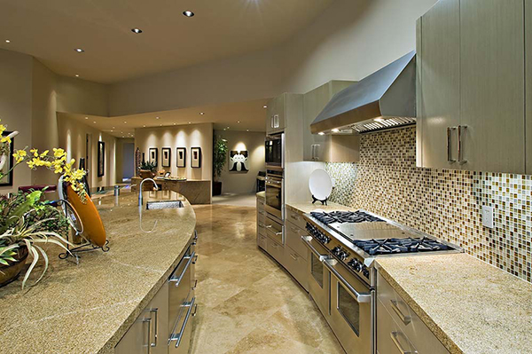 A large open kitchen with tile backsplash and floors