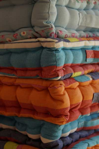 Upholstered cushions stacked on top of each other