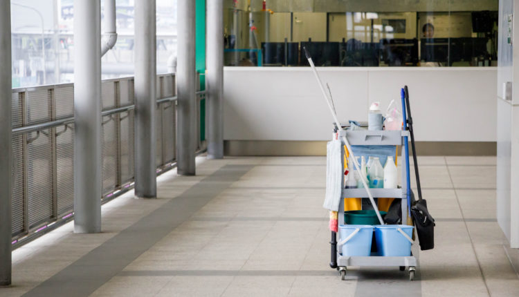 Janitorial cart with cleaning supplies in an office